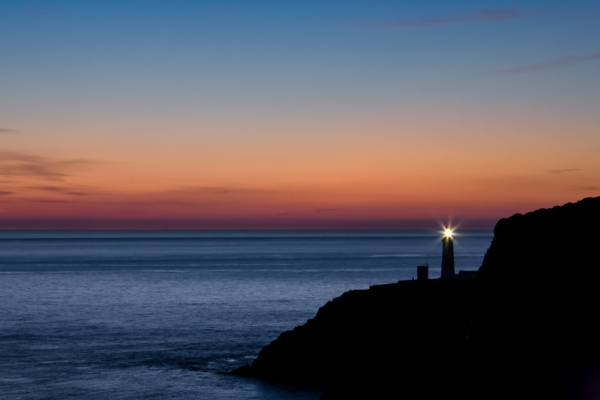 Every day at dusk the lighthouse begins it's show, warning sailors of the dangers they face should they come too close. Beautiful in sunset, there lurks beneath the beauty a savage land and unforgiving sea only too keen to reap careless souls.