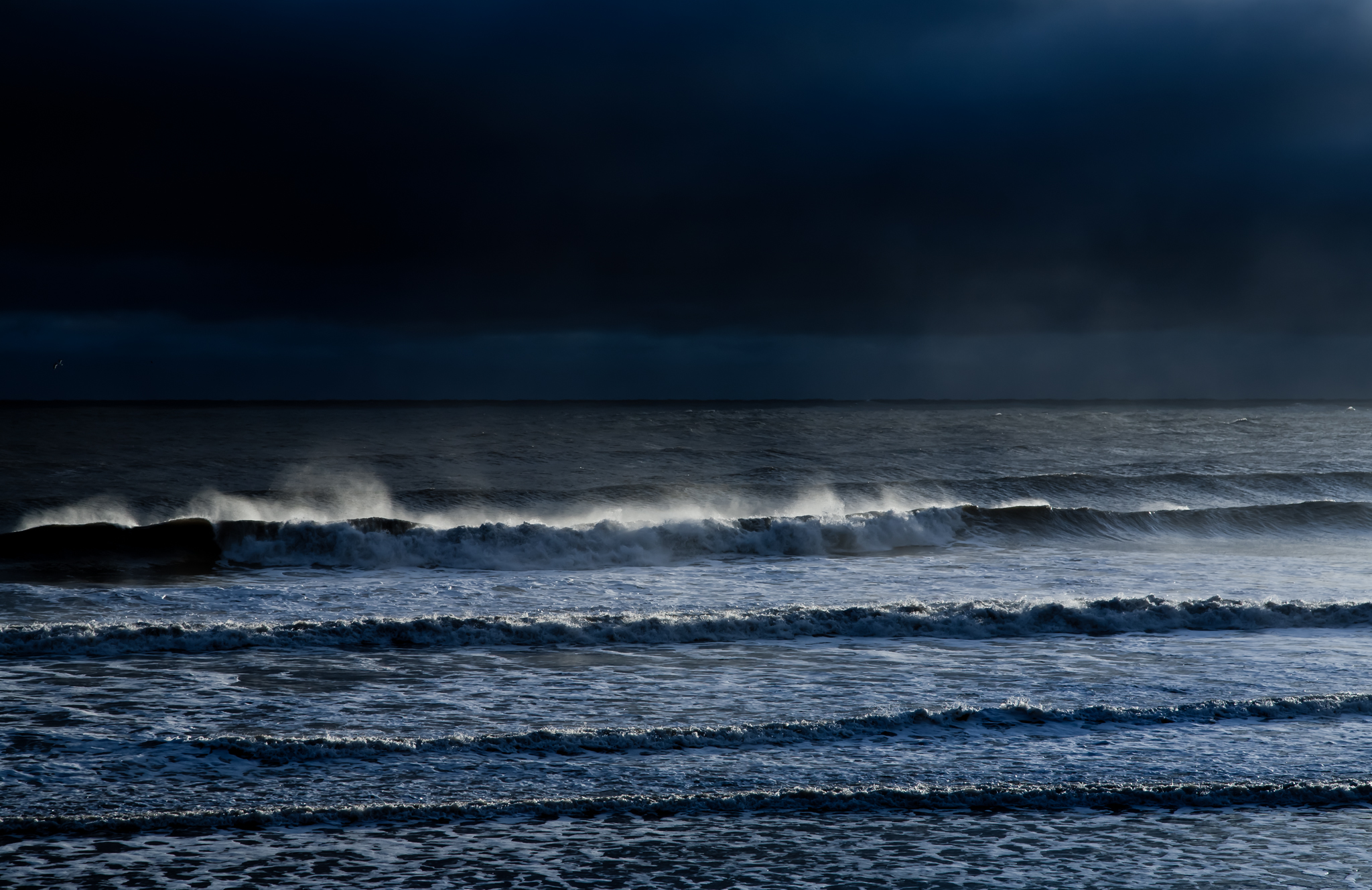 Waves are well known for their soothing effect, not just the sound but the colour, the shape and the constancy of them. This image perfectly captures the gamut of pleasure waves have to offer.