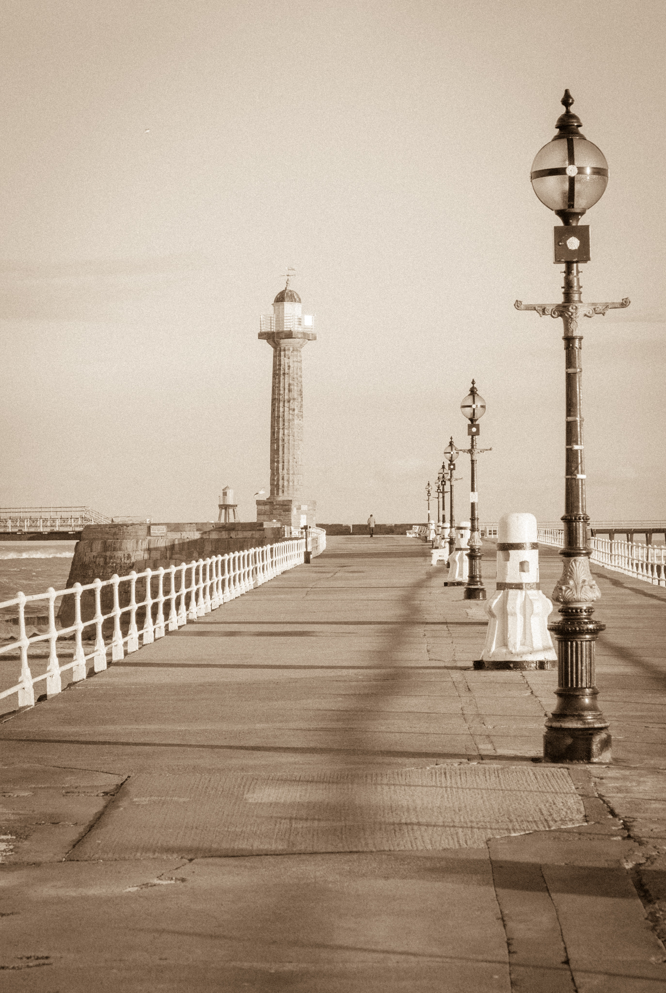 Whitby pier is not so much a blend of old and new, but more a celebration of old, having changed hardly at all since Nosferatu landed at the harbour. I've processed this image to reflect that 'time gone by' feel.